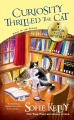 Product Curiosity Thrilled the Cat: A Magical Cats Mystery